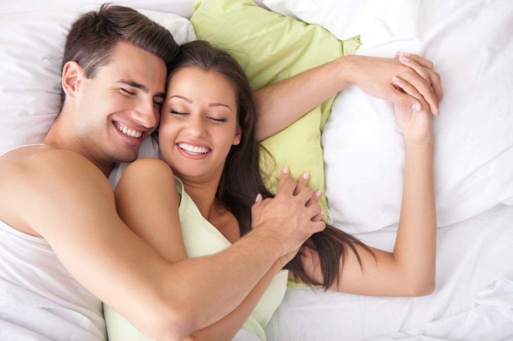 Young happy couple in bed